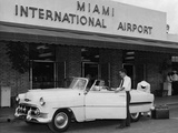 Travelers in a Chevy Bel Air Convertible at the Miami International Airport, 1954 August 22 Photographic Print