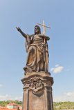 Statue of St. John the Baptist on Charles Bridge in Prague Photographic Print by  joymsk