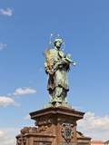 Statue of St. John of Nepomuk on Charles Bridge in Prague Photographic Print by  joymsk