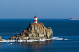 Lighthouse on a Cliff by the Sea. East (Japan) Sea. Photographic Print by  vladsv