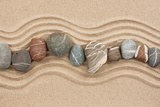 Striped Stones on the Sand Photographic Print by  alleks