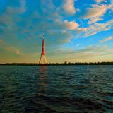 Televisional Tower of City Riga, There is Daugava on the Peninsula of the River. Photographic Print by  winstyle