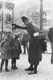 A Policemen Helps Some Children with Directions, 1923 Photographic Print