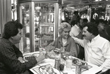 Enjoying Cuban Cuisine at Versailles Restaurant, 1987 Reprodukcja zdjęcia