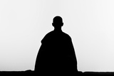 The Silhouette of a Zen Buddhist Nun Practicing Zen-Meditation (Zazen) Photographic Print