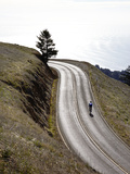 A Bicyclist Riding in Mount Tamalpais State Park, with the Pacific Ocean in the Distance Photographic Print by Keith Barraclough