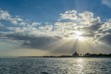 Sun Rays Pierce the Clouds over the Boca Grande Lighthouse on the Southern Tip of Gasparilla Island Photographic Print by Carlton Ward