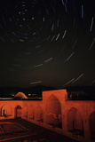 Time-Exposure of Star Trails around the North Celestial Pole over a Historic Caravansary, in Iran Photographic Print by Babak Tafreshi