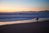El Porto Beach, Los Angeles, California, USA: A Surfer Exits the Waves at Dusk Stampa fotografica di Ben Horton