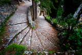 Stairs Descend Along a Cliffside Walkway in Moustiers-Sainte-Marie Photographic Print by Keith Ladzinski