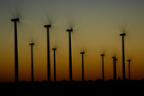 Silhouettes of a Windmills on a Wind Farm Photographic Print by Michael Forsberg
