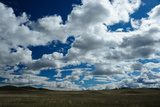 Rolling Hills with White Clouds and Blue Sky Fotografisk tryk af Michael Forsberg