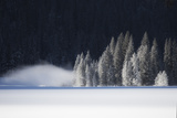A Low-Lying Mist Hovers over a Snowy Landscape Photographic Print by Robbie George