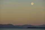 The Full Moon Sets as the Sunrise Stars over the Waters of the Inside Passage Photographic Print by Jonathan Kingston