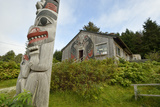 Totem Pole in Front of a Gift Shop in Old Masset Photographic Print by Jonathan Kingston