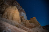 A Man Looks Up at Red Rocks in the Eastern Sierra Nevada Mountains Photographic Print by Ben Horton