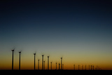 Sunset over a Wind Farm Photographic Print by Michael Forsberg