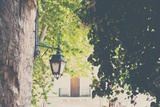 French Street Scene with Wall Light Photographic Print by Laura Evans