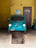 Small Car in Garage Photographic Print by Bernardo Bonnefon