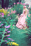 A Beautiful Princess with Long Blond Hair Wanders Through a Garden of Pretty Flowers Photographic Print by Winter Wolf