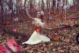 Young Adult Female with Butterflies in Woods Photographic Print by Ariel Marie Miller