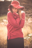 Young Woman Outdoors Wearing a Red Hat Photographic Print by Sabine Rosch