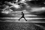 Young Woman Jumping on Beach Photographic Print by Rory Garforth