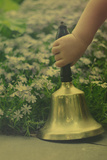 Child's Hand Holding Bell Photographic Print by Elizabeth Urqhurt