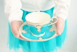 Close Up of Young Girl Holding Cup and Saucer Photographic Print by Susannah Tucker