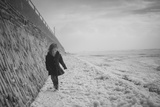 Young Girl Walking Beside the Sea Wall in England During Winter Photographic Print by Clive Nolan