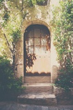 French Building with Doorway under Dappled Sunlight Photographic Print by Laura Evans