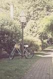 Childs Bike Against Lampost Photographic Print by Jillian Melnyk