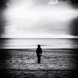 Female Figure Standing Alone on Beach Photographic Print by Rory Garforth
