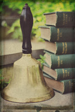 Teachers Bell and Books Photographic Print by Elizabeth Urqhurt