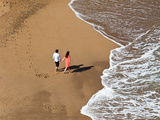 Two People on Beach Photographic Print by Bernardo Bonnefon