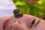 Snail on Face Photographic Print by Bernardo Bonnefon