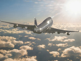 Jumbo Jet Above Clouds Into Sunlight Alu-Dibond von Peter Walton