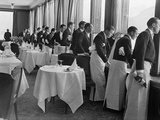 Waiters in the Grand Hotel Dining Room Lined Up at Window Watching Sonja Henie Ice Skating Outside Metal Print by Alfred Eisenstaedt