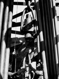 Workers Lower Pipe into Oil Well Inside Rig in a Texaco Oil Field Metal Print by Margaret Bourke-White