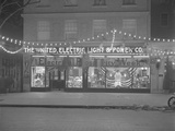 United Electric Light and Power Company Storefront Decorated for 'Electrical Prosperity Week' Photographic Print by William Davis Hassler