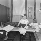 Unidentified Little Girl Demonstrating the Use of an Electric Iron, C.1913-14 Photographic Print by William Davis Hassler