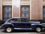 Vintage Car Parked Next to the Bacardi Rum Building in Havana, Cuba Posters by Carol Highsmith