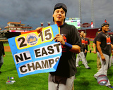 Wilmer Flores celebrates the Mets winning the 2015 National League East Division Photo