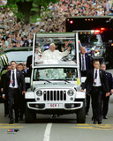 Pope Francis waves to the crowd as he rides through New York's Central Park- Friday, September 25,  Photo