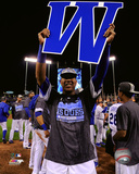 Salvador Perez holds up a W after the Royals clinched the 2015 American League Central Division tit Photo