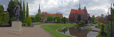 Botanical Gardens with Collegiate and Cathedral Towers in the Background, Krakow, Poland Photographic Print by Panoramic Images