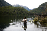 A Woman, Using a Fly Rod, Fishes for Spawning Salmon Photographic Print by Michael Hanson