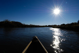 View of the Sun Shining on a River from a Canoe Photographic Print by Michael Forsberg