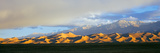 Sand Dunes in a Desert with a Mountain Range in the Background Photographic Print by Panoramic Images