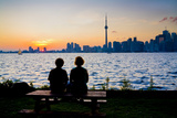 A Couple Watches the Sunset over Toronto Skyline from Centre Island Photographic Print by Tim Thompson